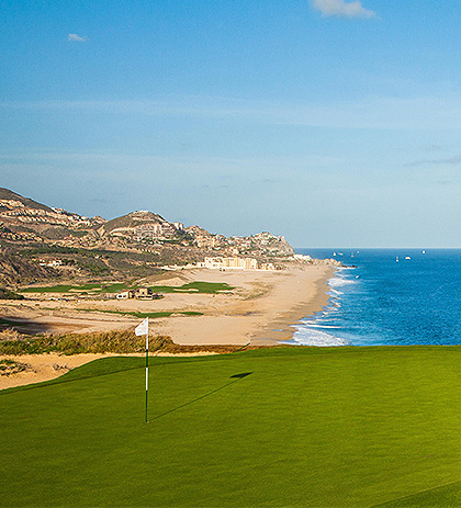 golf course with beach and ocean in the background
