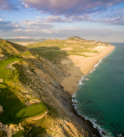 golf course on the cliff leading into the water