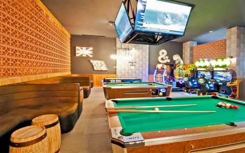 Recreation room with pool tables and arcade games