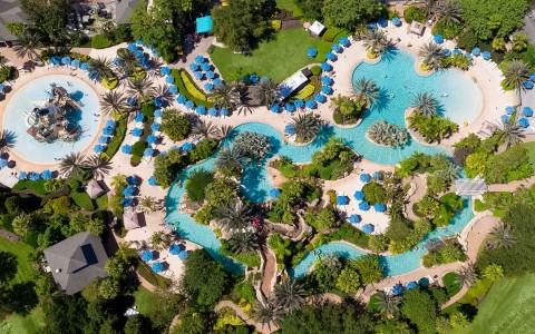 aerial view of property and water park pool