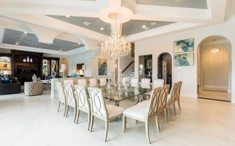 large dining table and multiple elegant chairs in a spacious room