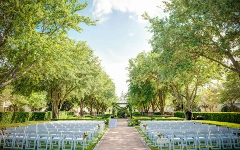 empty chairs prepared for an outside wedding