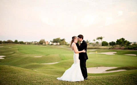newlyweds kissing out at the golf course