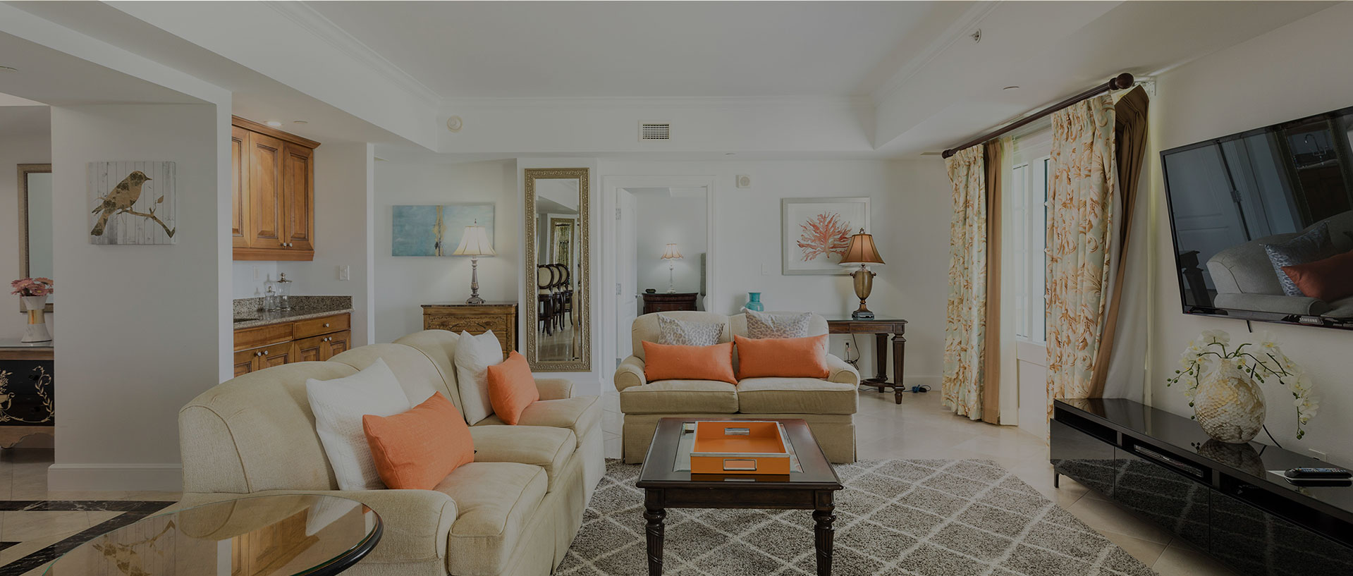 living room with orange accents dark overlay
