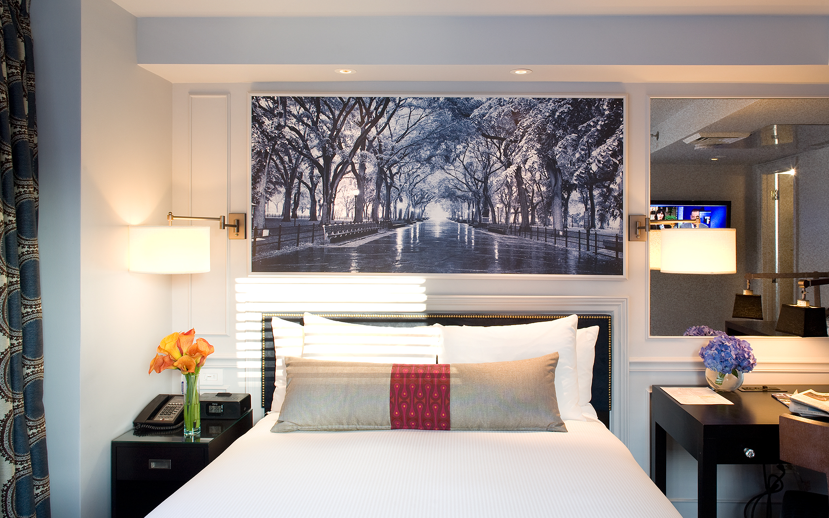 Deluxe King guestroom features one king bed with luxurious down bedding