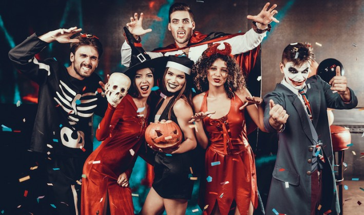 group of people in halloween costumes