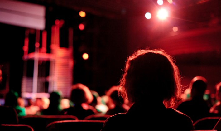 people watching a show in an auditorium