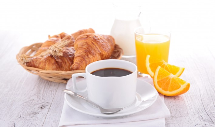 breakfast pastries with coffee and juice