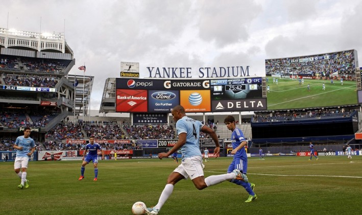 soccer teams playing at the Yankee stadium