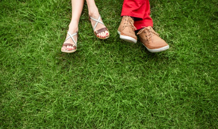 couple's shoes in grass
