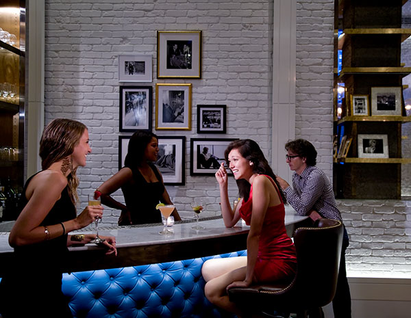 people drinking at an upscale bar in the roger new york