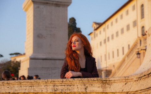 woman overlooking a balcony in rome