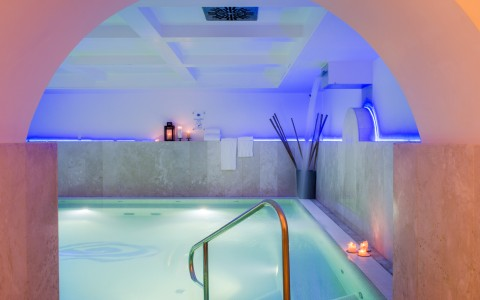 indoor whirlpool with pink and blue lighting