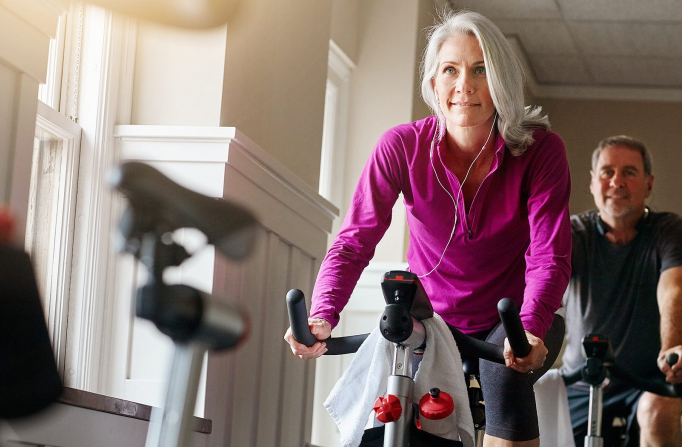 Older woman on elliptical at Fitness center