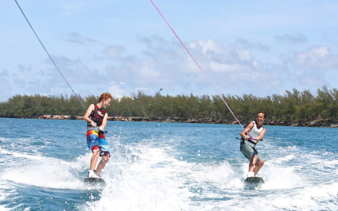 two young men wake boarding