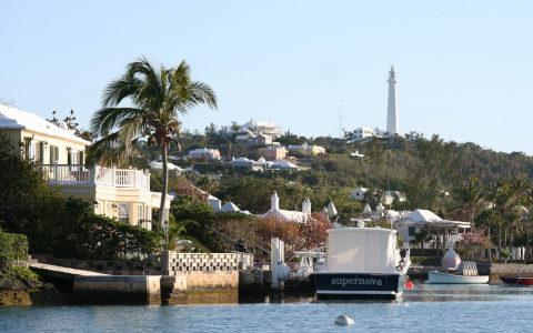 White buildings on hill overlooking water
