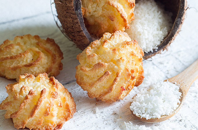 Coconut Macaroons on table with spoon full of shredded coconut
