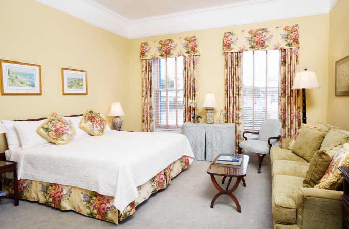 Rosedon Rooms Luxry Main House with one bed, a couch, coffee table, and large windows