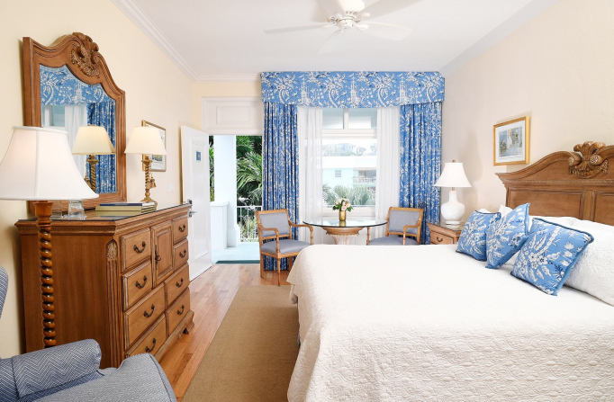 Rosedon Rooms Standard Room 3 with large bed dresser table chairs and a large window