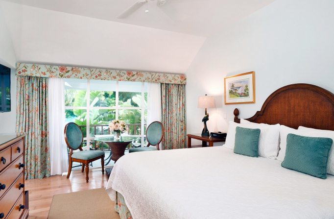 Rosedon Rooms Superior Room 2 with large white bed dresser tables and chairs and large window