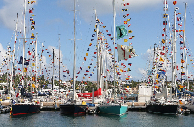 Sailboats with small flags tied all over sail