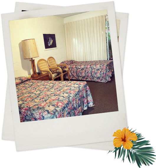Polaroid of two queen beds with two chairs, lamp, and picture frame