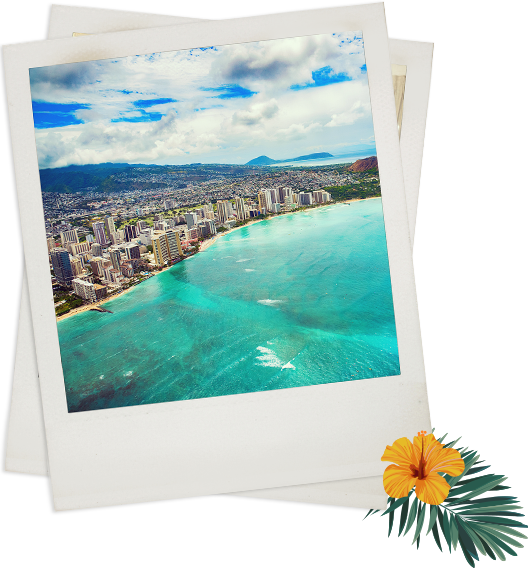 aerial view of waikiki coast and turquoise blue waters