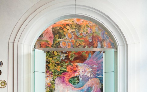 Open doors with view of large mural