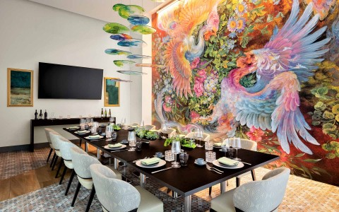 Private dining table next to mural