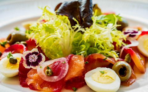 Salad with olives and boiled eggs