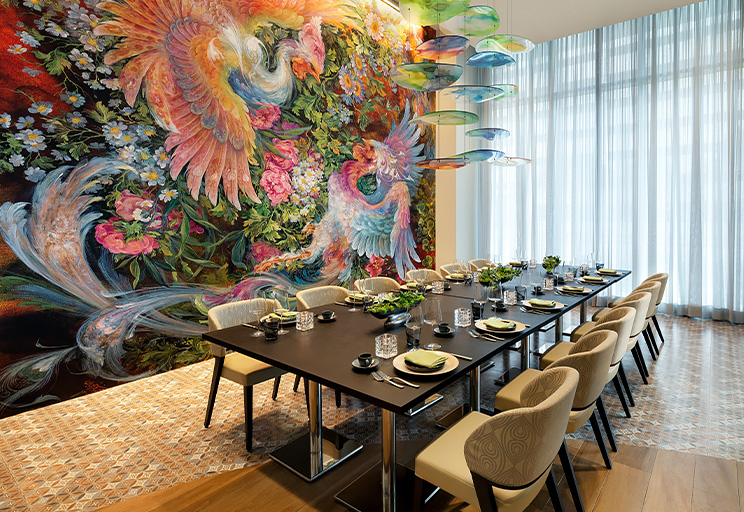 Private dining table next to colorful mural