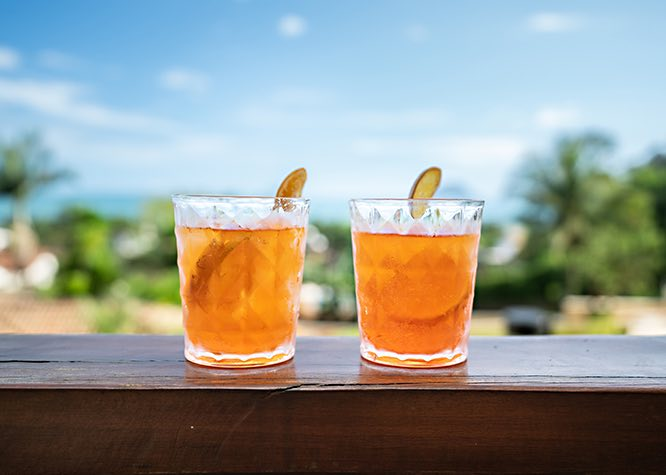 Two cocktails with lime on edge