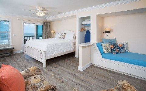 Room with king bed and ocean view from balcony