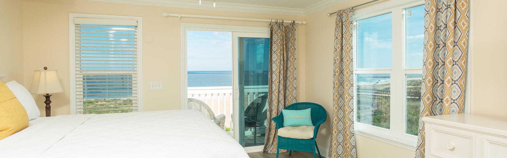 Room with king bed and wide view of ocean