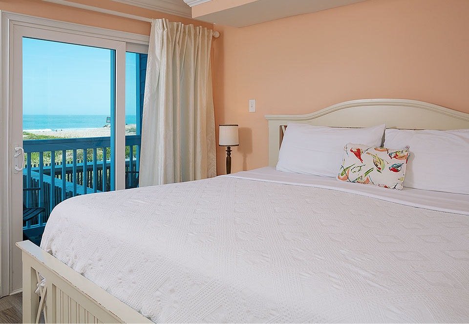 Room with large bed next to private balcony