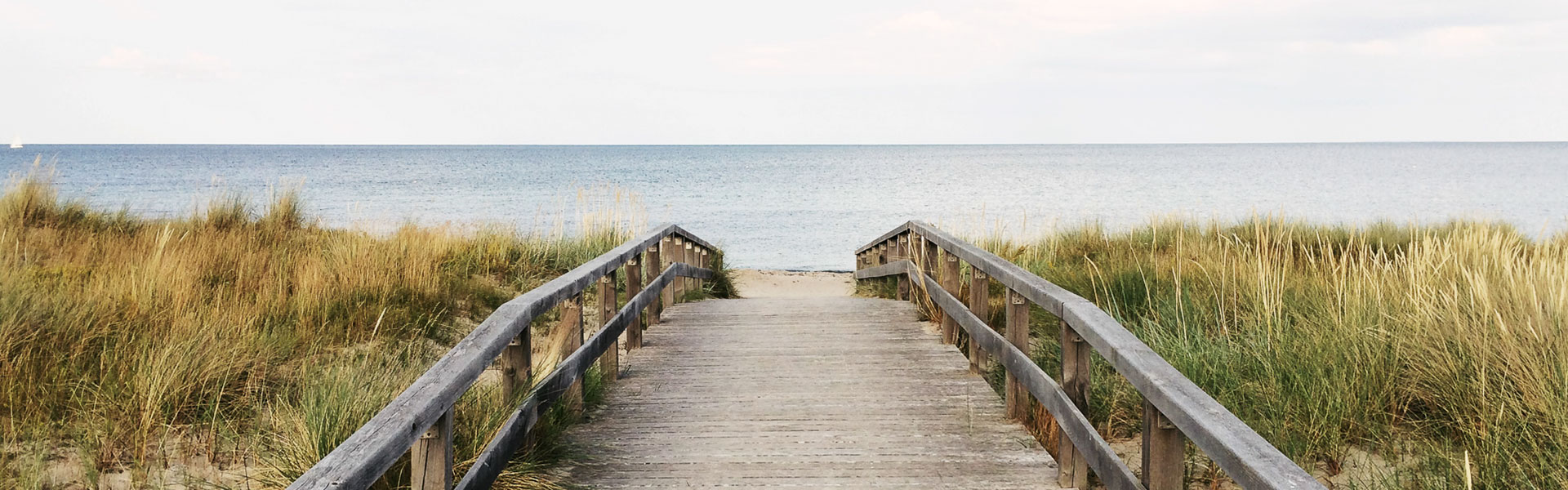 wooden boardwalk leading to beach