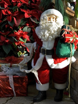Hand Crafted Santa with Presents and Poinsettias