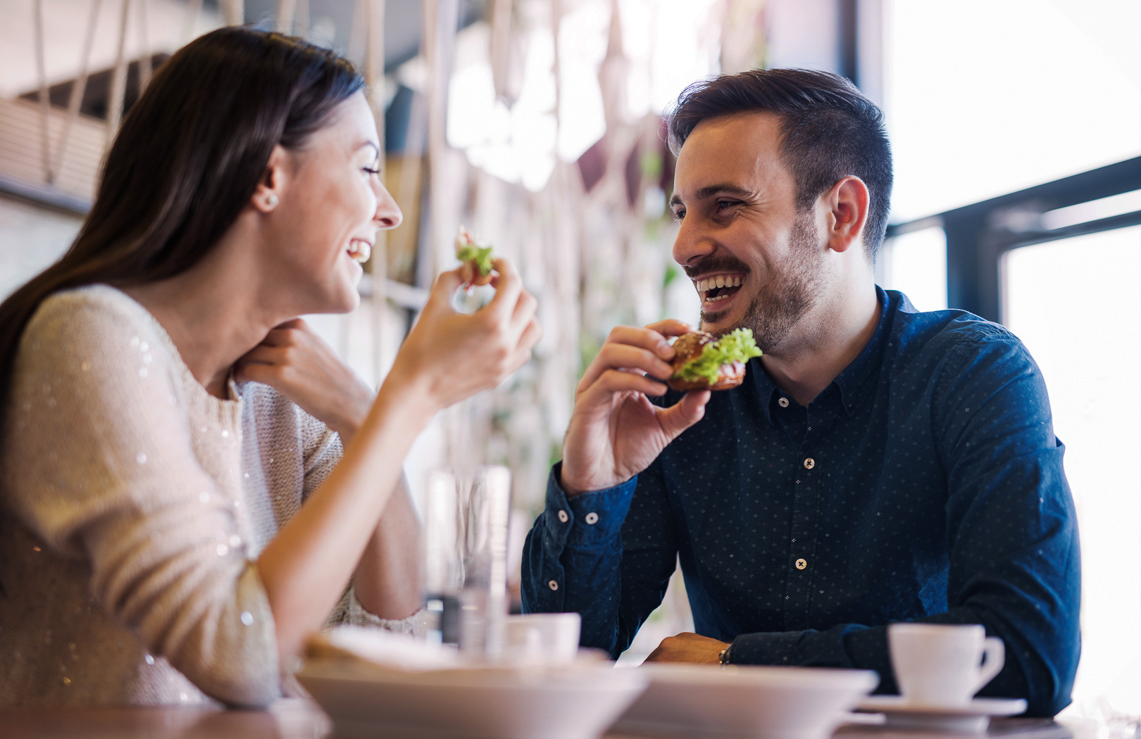 man and woman eating together and smiling