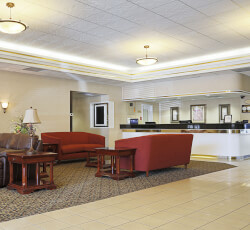 Hotel lobby with red sofas and check in counter