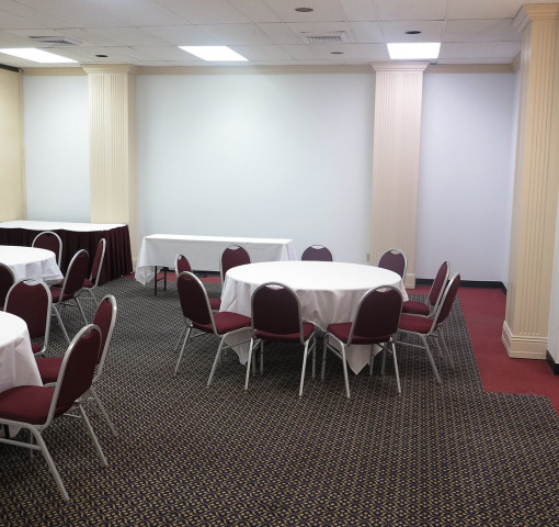 Heritage Meeting Room With Round Tables And Chairs