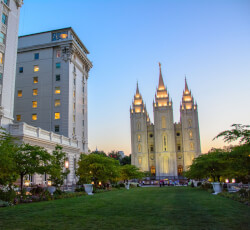 Temple square grassy field and buildings at dusk