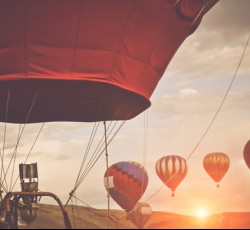 hot air balloons with sunrise