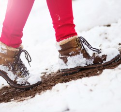 close up of woman hiking shoes in snow