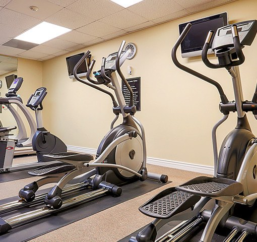 Two stair stepper machines in hotel fitness room