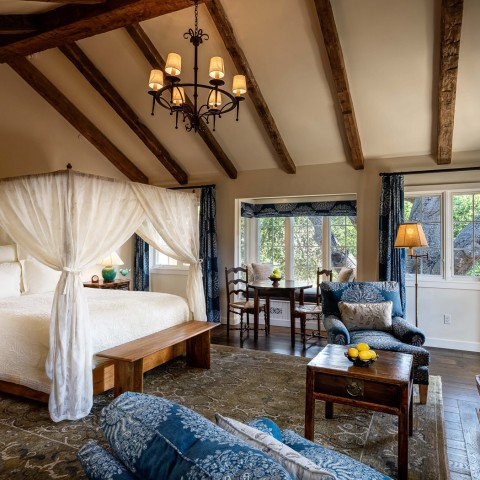 san ysidro cottage canopy bed and seating area