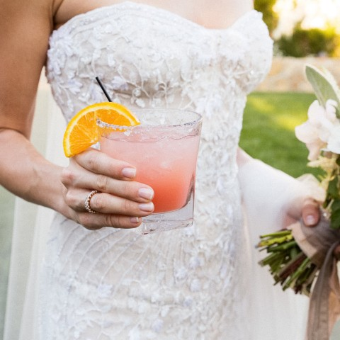 bride holding a cocktail