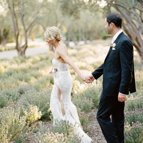bride and groom strolling in san ysidro garden