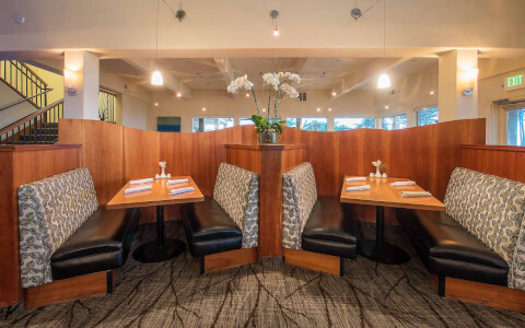 wood booths in the dining room at sanderlings