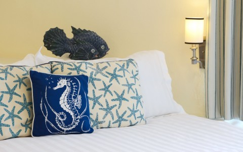 closeup of the bed with starfish pillows