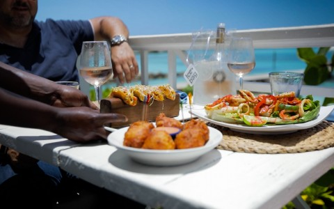 food served on a table overlooking the beach